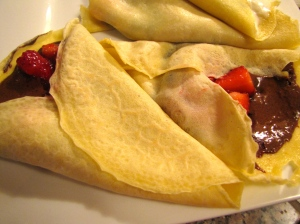 Crepes with nutella and strawberry syrup